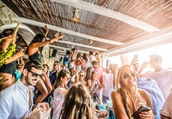 daytime party in the bar at Nammos beach club on Mykonos, Greece