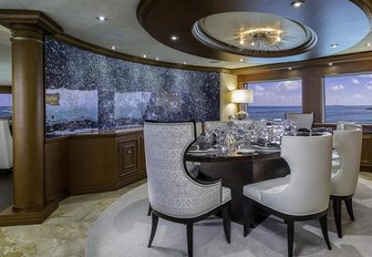 Makassar ebony dining table in the main salon aboard superyacht M3