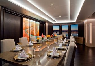 interior dining area with back-lit glass feature on board superyacht Mogambo