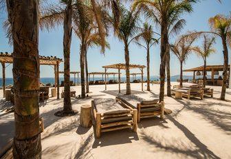 sun loungers at Scorpios, Mykonos, Greece