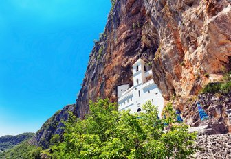 Ostrog Orthodox monastry perches on rocky cliff in Montenegro