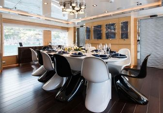 modern dining area in the main salon aboard superyacht RESILIENCE