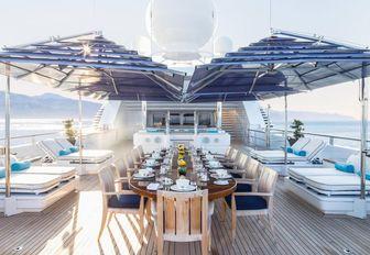 beautiful alfresco dining area on upper deck of luxury yacht TITANIA