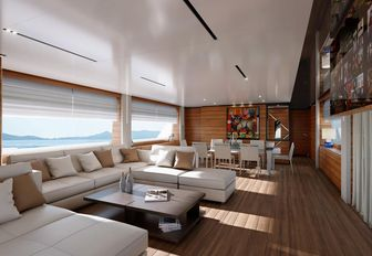 the main salon of charter yacht penelope with earthy tones and cream furnishings