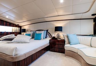 Owner's cabin motor yacht HEMILEA, with corner sofa and cream colour palette
