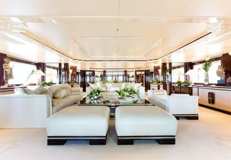 The bright white furnishings which make up the main salon of superyacht Lioness V