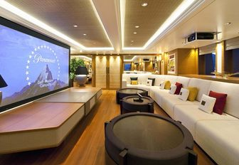 long sofa faces wide-screen TV in the skylounge of motor yacht Mary-Jean II