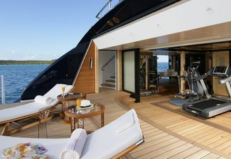 Beach club onboard yacht charter AMARYLLIS, sun loungers on swim platform with direct access to gym aft.
