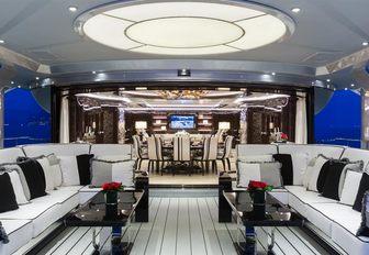 chic alfresco lounge on aft deck of luxury yacht OKTO