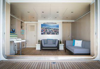chic beach club with bar aboard superyacht TITANIA
