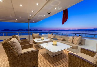 sumptuous seating area on the main deck aft of motor yacht Lucky Lady