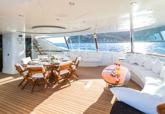 al fresco dining area and seating in the aft cockpit aboard luxury yacht Q