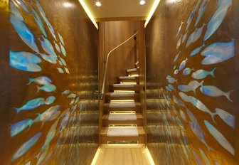 walls inlaid with fish shapes in corridor on the lower deck of charter yacht SOLIS