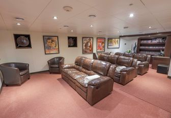 movie theater with plush reclining sofas on board luxury yacht GLOBAL