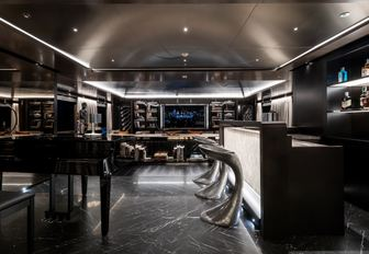 bar, piano and seating area in the skylounge aboard charter yacht SOLO