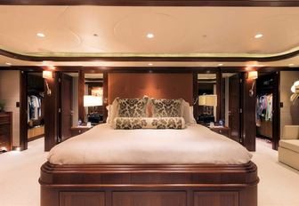 full-beam master suite with large central bed aboard superyacht SAFIRA
