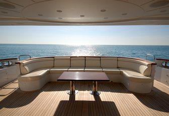 u-shaped seating on the main deck aft of charter yacht 'Elena Nueve'