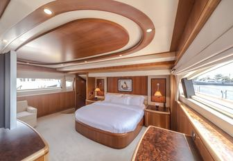 warm woods and large windows in master suite aboard motor yacht Antonia II