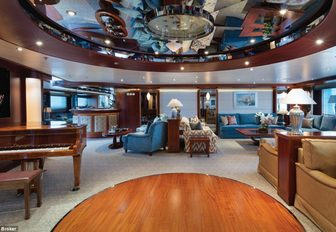 piano and seating areas in the main salon aboard superyacht 'Lauren L'