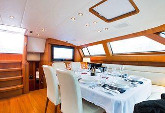 dining area in main salon of luxury yacht RAPTURE