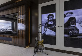 Mick Jagger doors and vintage guitar in the skylounge of luxury yacht 'King Baby'