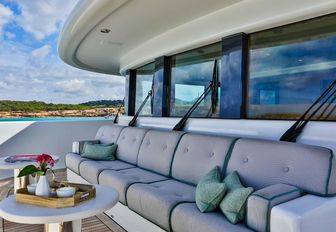 foredeck seating area with table on board superyacht DENIKI