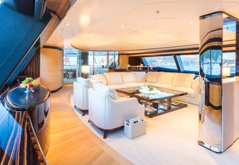 u-shaped sofa sits at the centre of the main salon aboard charter yacht Q