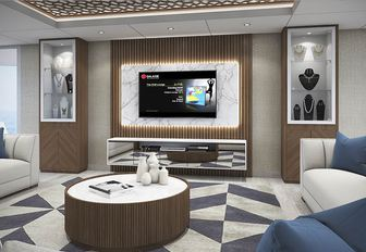 sofas face a TV in the main salon of charter yacht ELITE
