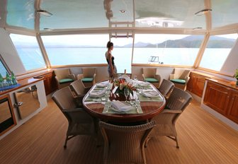 dining for six on enclosed aft deck of luxury yacht BAHAMA