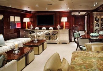 laid-back skylounge with seating, bar and games table on board superyacht Lady Joy