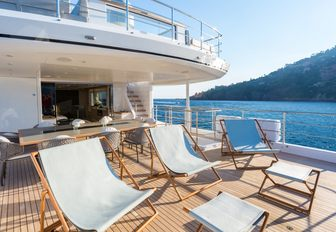alfresco dining and deck chairs line upper deck aft of motor yacht NARVALO