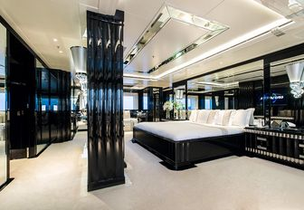 Art Deco-themed master suite with black lacquered surfaces aboard motor yacht Silver Angel