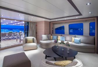 seating area and door opening onto deck in the skylounge on board luxury yacht DYNAR