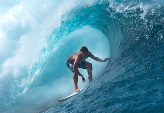 a gfuest on a luxury yacht charter in tahiti decides to take part in some water sorts and surfs the cinematic waves of the region
