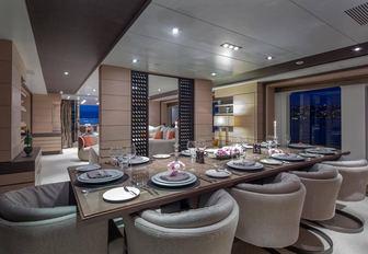 formal dining area in the main salon of motor yacht DYNAR