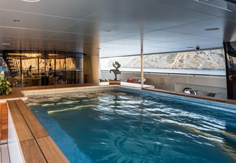 A shot which shows the large swimming pool full of water on board luxury yacht 'Here Comes The Sun'