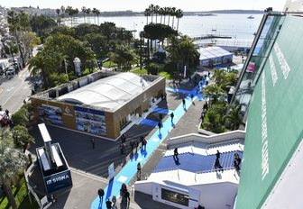 aerial view of MIPIM with attendees on blue carpet outside Palais des Festivals