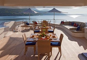 tables set for dinner on the sundeck of charter yacht Mary-Jean II
