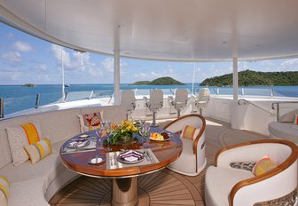 seating area set for a lunch on the forward part of the sundeck on board luxury yacht AMARYLLIS