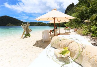 discover secluded and empty beaches on a charter vacation in South East Asia aboard luxury phinisi LAMIMA