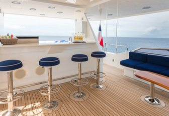 the sundeck of charter yacht all in is fit with all the luxury amenties that a charter guest might need to enjoy their luxury yacht charter vacation in the bahamas