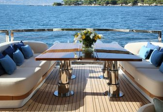alfresco dining spot on the aft deck of charter yacht SOLIS