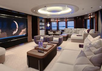 Cinema room with white sofas and wide screen TV on board charter yacht DREAM