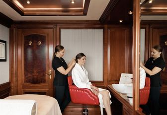 charter guest get her hair done in the salon aboard charter yacht TITANIA