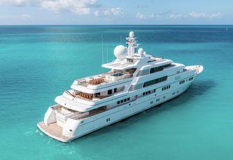 superyacht Titania sailing over calm turquoise ocean