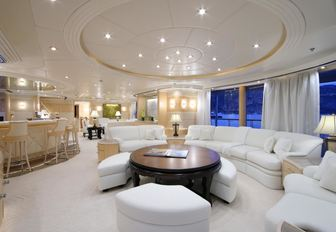 white, light and airy skylounge with bar and sofas on board superyacht CAPRI