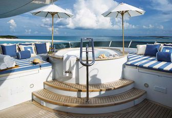 jacuzzi surrounded by sunpads on the sundeck of motor yacht 'Lady Joy'