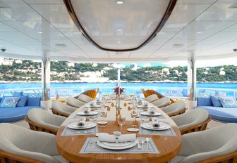 main alfresco dining area on the expansive upper deck aft of charter yacht My Seanna