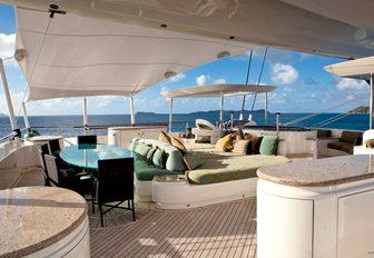 dining and sunning options on the flybridge aboard superyacht HEMISPHERE