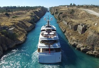 motor yacht St David cruising through the Corinth Canal on a Greece yacht charter